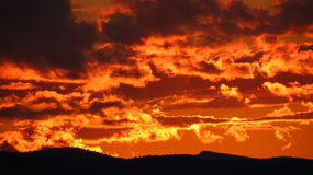 Fiery Sunset. Dark fiery orange sunset over distant mountains Royalty Free Stock Image