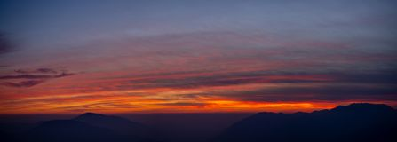Fiery sunset from mountain peak in a cloudy evening. Fall season. Orobie mountains. Italian Alps. Fiery sunset from mountain peaks in a cloudy evening. Fall royalty free stock photos