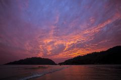 Sunset in Goa, India. Fiery sunset on one of the wildest beach in Goa, India Stock Photos