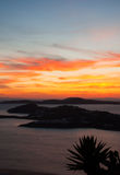 Fiery sunset over the islands of Mykonos Royalty Free Stock Image