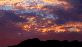 Fiery Sunset over the Mountain peaks Stock Photography