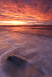 Fiery sunset over sea. Dramatic firey sunset over Baltic sea Royalty Free Stock Images
