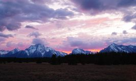 Fiery Sunset over the Tetons royalty free stock images