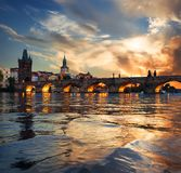 Fiery sunset in Prague. Fiery sunset over Charles bridge on river Vltava in Prague royalty free stock photography