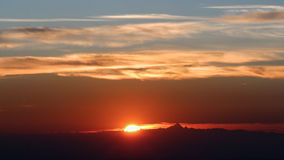 Fiery sunset. Red fiery sunset behind Mount Monviso Stock Image