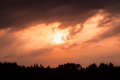 Fiery sunset and silhouette forest Stock Photography