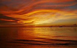 Fiery sunset streaks, Saipan. Gorgeous streaks of fiery skies and water reflection. Northern Mariana Islands stock photos