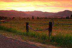 Fiery sunset in the Wasatch Mountains. Fiery sunset clouds above farm fields, Utah, USA Royalty Free Stock Photos