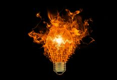 A fiery symbol. Bright a fiery symbol on the black background, burning lamp, the lamp is on fire Stock Images