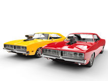 Fiery vintage muscle cars. Isolated on white background Stock Photos