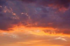 Fiery vivid sunset sky clouds Stock Photos