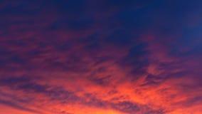 Fiery vivid sunset sky clouds Stock Photo