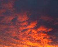 Fiery vivid sunset sky clouds Royalty Free Stock Photos
