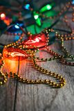 Fiesta: Colorful Bead Necklace Amongst Glowing Party Lights stock image