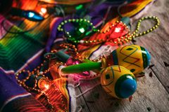 Fiesta: Colorful Maracas Amongst Cinco Beads And Lights. A series of background images for Cinco De Mayo fiesta celebrations. Margaritas, tacos, serape, lights