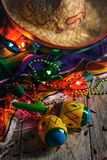 Fiesta: Colorful Maracas Amongst Cinco Beads And Lights. A series of background images for Cinco De Mayo fiesta celebrations.  Margaritas, tacos, serape, lights stock images