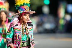 The Fiesta DC Parade. Washington, D.C., USA - September 29, 2018: The Fiesta DC Parade, bolivian woman wearing traditional clothing walking down the street royalty free stock photography