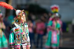 The Fiesta DC Parade. Washington, D.C., USA - September 29, 2018: The Fiesta DC Parade, children from bolivia wearing traditional clothing walking down the royalty free stock images