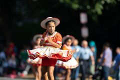 The Fiesta DC Parade. Washington, D.C., USA - September 29, 2018: The Fiesta DC Parade, Young Bolivian girl wearing traditional clothing going down the street royalty free stock photo