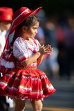 The Fiesta DC Parade. Washington, D.C., USA - September 29, 2018: The Fiesta DC Parade, Young Bolivian girl wearing traditional clothing going down the street royalty free stock image