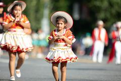 The Fiesta DC Parade. Washington, D.C., USA - September 29, 2018: The Fiesta DC Parade, Young Bolivian girl wearing traditional clothing going down the street royalty free stock images