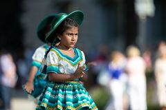 The Fiesta DC Parade. Washington, D.C., USA - September 29, 2018: The Fiesta DC Parade, Young Bolivian girl wearing traditional clothing going down the street royalty free stock photos