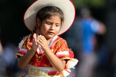 The Fiesta DC Parade. Washington, D.C., USA - September 29, 2018: The Fiesta DC Parade, Young Bolivian girl wearing traditional clothing going down the street stock images