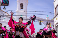 Fiesta de la Virgen Guadalupe in Sucre. Sucre, Bolivia on September 12, 2015: Dancers in colorful dresses in front of colonial buildings at Fiesta de la Virgen Stock Photography