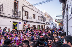 Fiesta de la Virgen Guadalupe in Sucre. Sucre, Bolivia on September 12, 2015: Full street in center of sucre at parade with Bolivians in costumes at the annual Royalty Free Stock Photos