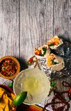 Fiesta: Food And Drink To Celebrate Cinco De Mayo. A series of background images for Cinco De Mayo fiesta celebrations.  Margaritas, tacos, serape, lights, and royalty free stock images