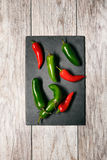 Fiesta: Jalepeno Peppers On Slate Cutting Board Stock Photos