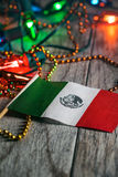 Fiesta: Mexican Flag Amongst Party Favors And Decorations royalty free stock photography