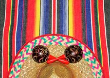 Poncho mexican sombrero Fiesta Mexico rug in bright colors with sombrero background with copy space. Poncho Mexican sombrero Fiesta Mexican poncho rug background stock photos