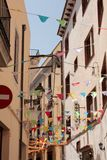 Fiesta street near Barcelona with colorful flags Royalty Free Stock Photography