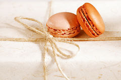 Fiestive macarons on gift present box Stock Photos