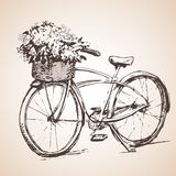 Fiets met grote bos van bloemen schets Stock Foto's