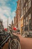 Fietsen en Amsterdam Royalty-vrije Stock Foto's