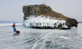 Fietstoerist op het ijs stock afbeelding
