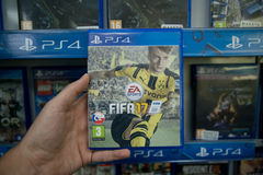 Fifa 17. Bratislava, Slovakia, circa april 2017: Man holding Fifa 17 videogame on Sony Playstation 4 console in store Stock Image