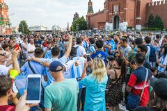 The 2018 FIFA World Cup. Argentine fans in striped white-blue t-shirts in colors of the flag of Argentina chanting chants on Red s Royalty Free Stock Photography
