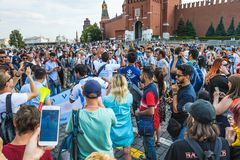 The 2018 FIFA World Cup. Argentine fans in striped white-blue t-shirts in colors of the flag of Argentina chanting chants on Red s Stock Photos