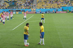 FIFA WORLD CUP BRAZIL 2014. Neymar and Marcelo discuss strategy during the World Cup against Croacia, on June 12, 2014 royalty free stock image