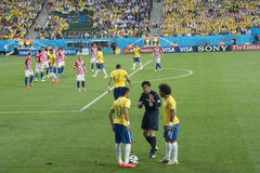 FIFA WORLD CUP BRAZIL 2014. Neymar and Marcelo talks to the referee in the World Cup against Croacia, on June 12, 2014 royalty free stock photo