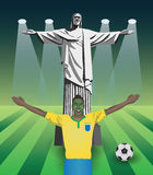 Fifa world cup fan with christ the redeemer statue. On pitch with spotlight Royalty Free Stock Images