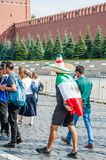 The 2018 FIFA World Cup. Mexican fan in sombrero and with Mexico flag on his shoulders on Red square. MOSCOW, RUSSIA - June 29, 2018: The 2018 FIFA World Cup stock photos