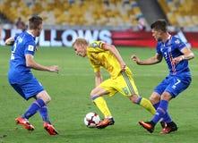 FIFA World Cup 2018 qualifying game Ukraine v Iceland. KYIV, UKRAINE - SEPTEMBER 5, 2016: Viktor Kovalenko of Ukraine (C) fights for a ball with Birkir Stock Image