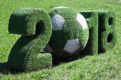 Fifa World Cup Russia 2018. ST. PETERSBURG, RUSSIA - MAY 09, 2018: Football Figure Symbol of FIFA World Cup 2018. Closeup. With background made of green grass royalty free stock images