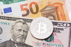 Fifry dollar and fifty euro background covered with silver bitco. In.  High resolution photo Royalty Free Stock Photo
