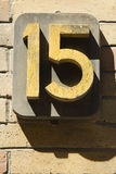 Fifteen. Bold number fifteen on sandstone brick wall Royalty Free Stock Image