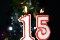 Fifteen birthday. Candle with bokeh background Royalty Free Stock Photo